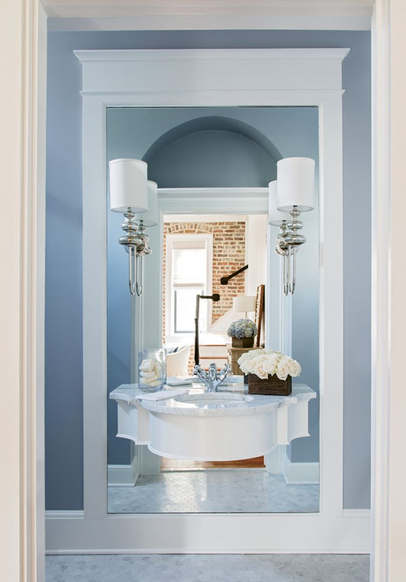 Optical Illusion: As the powder room lacked the depth for a vanity, Peake floated the sink on a mirrored wall, giving the petite space some wow factor.