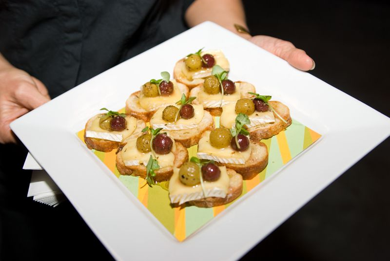 Roasted grapes on brie, crostini, and local honey from Cru Catering