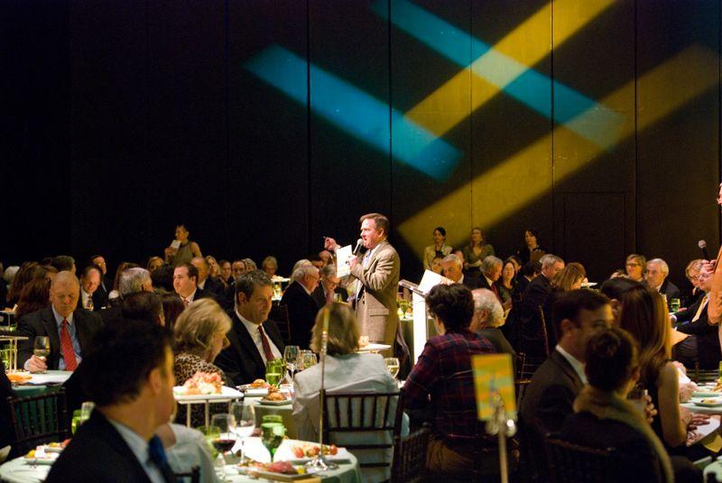 Guests participate in a vigorous live auction