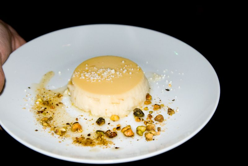 Orange blossom flan with salted caramel and candied pistachios from Cru Catering