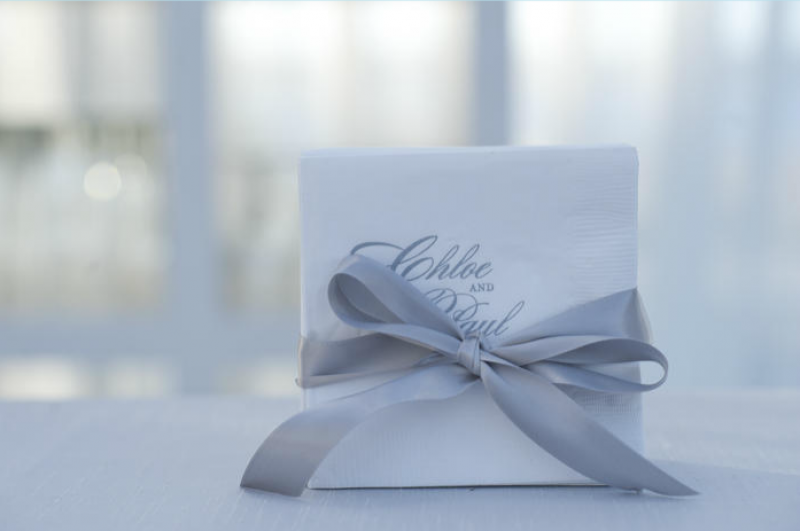 PAPER PRETTIES: Cocktail napkins bore the bride's and groom's names and matched the reception's frosty palette