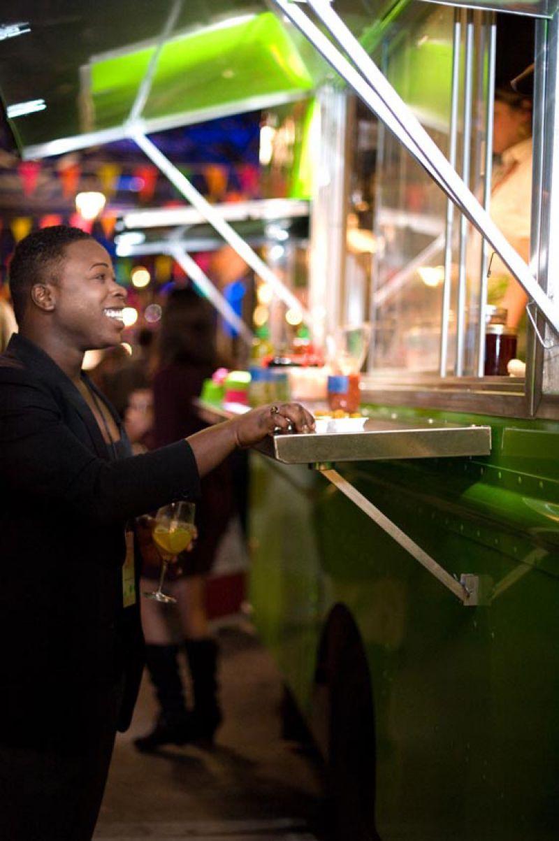 Demetrius Washington samples the Roti Rolls tasty fare