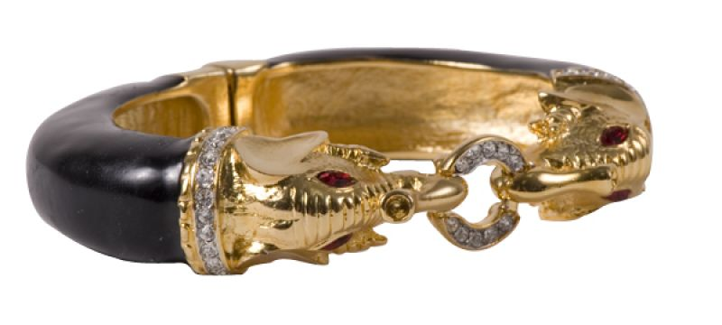 Kenneth Jay Lane gold and black enamel elephant head bracelet with diamond accents and red rhinestone eyes, $220 at Rapport