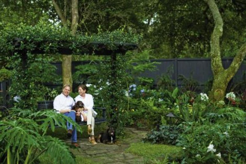 Backyard Oasis: Tommy and Sterling with their Boykin spaniel, Gibbes, and rescue hound, Walker.