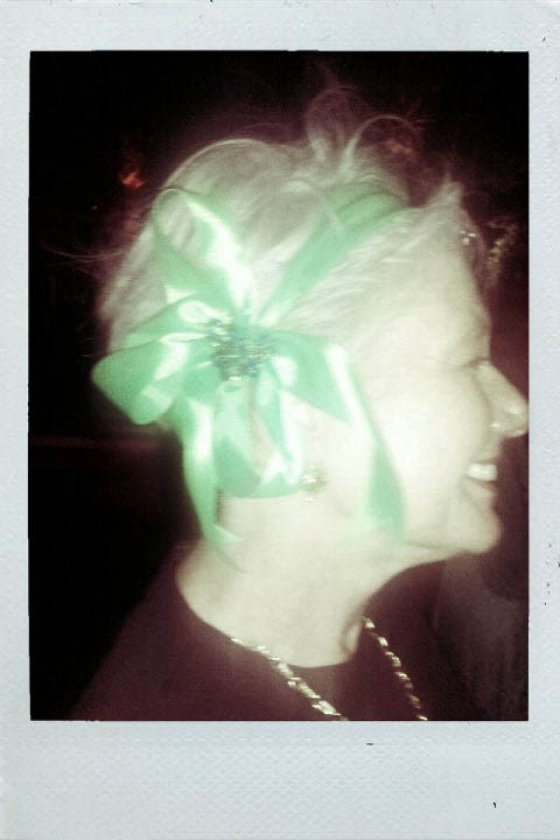 Lynn adds a great ribboned headpiece to her look.