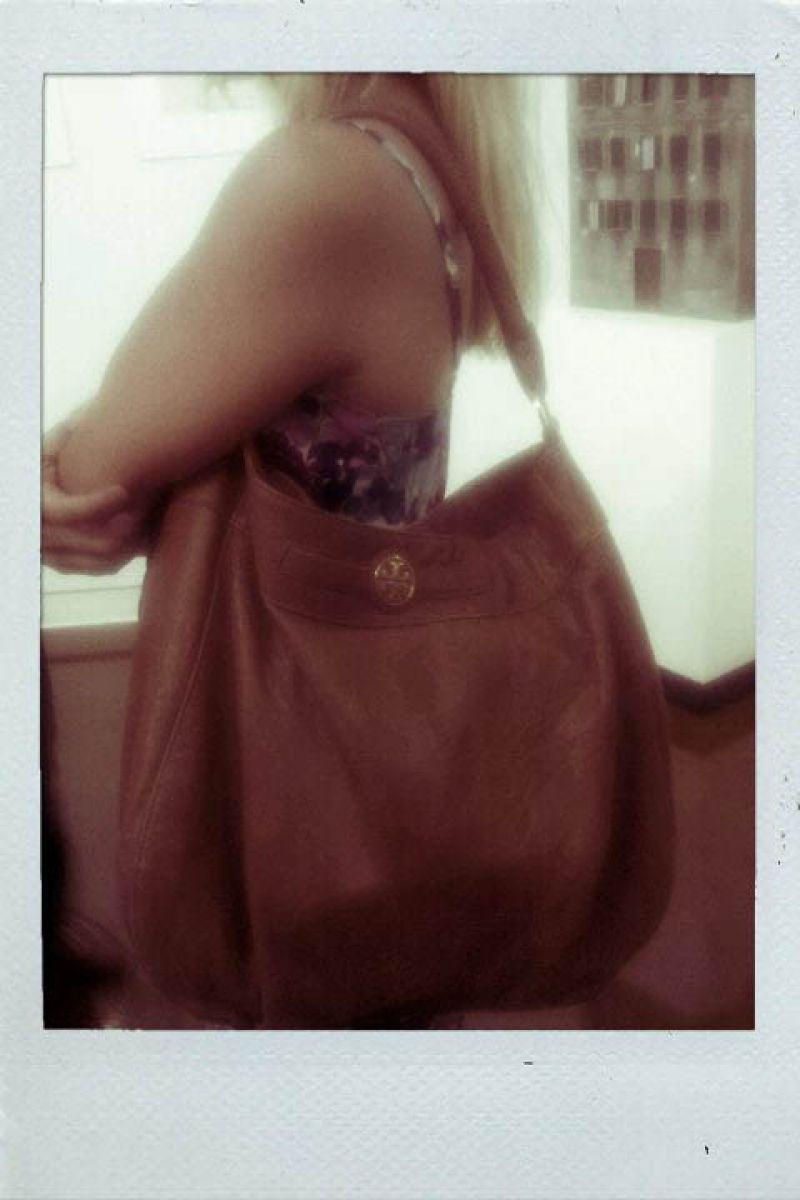 Lauren's stylish oversized Tory Burch handbag.