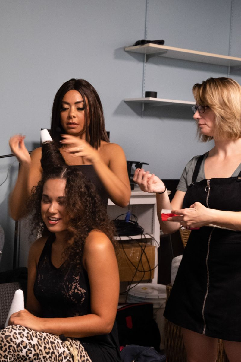 Andrea Serrano helps a fellow Spice Girl prep for the show.