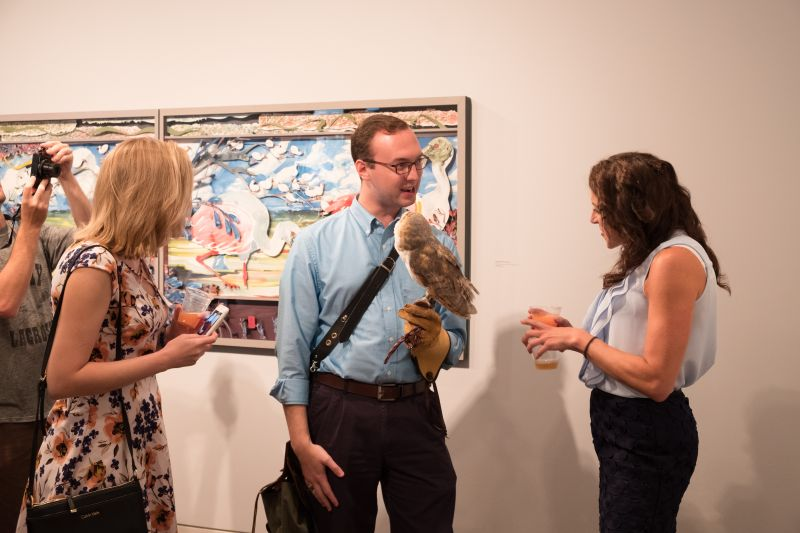 Marie Delcioppo inquires about the owl, handled by Daniel Prohaska of The Center for Birds of Prey.