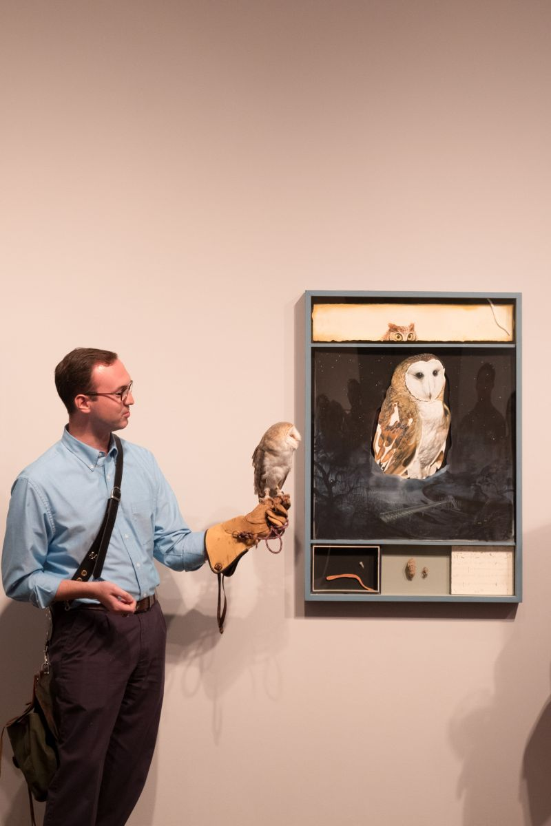 Daniel Prohaska of the Center for Birds of Prey shows off the owl next to its likeness.
