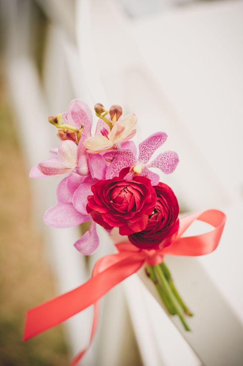 ORGANIC COMPOUND: Branch Design Studio fashioned a bridal bouquet of crimson ranunculus