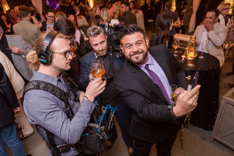 Adam Richman takes a selfie with his film crew.