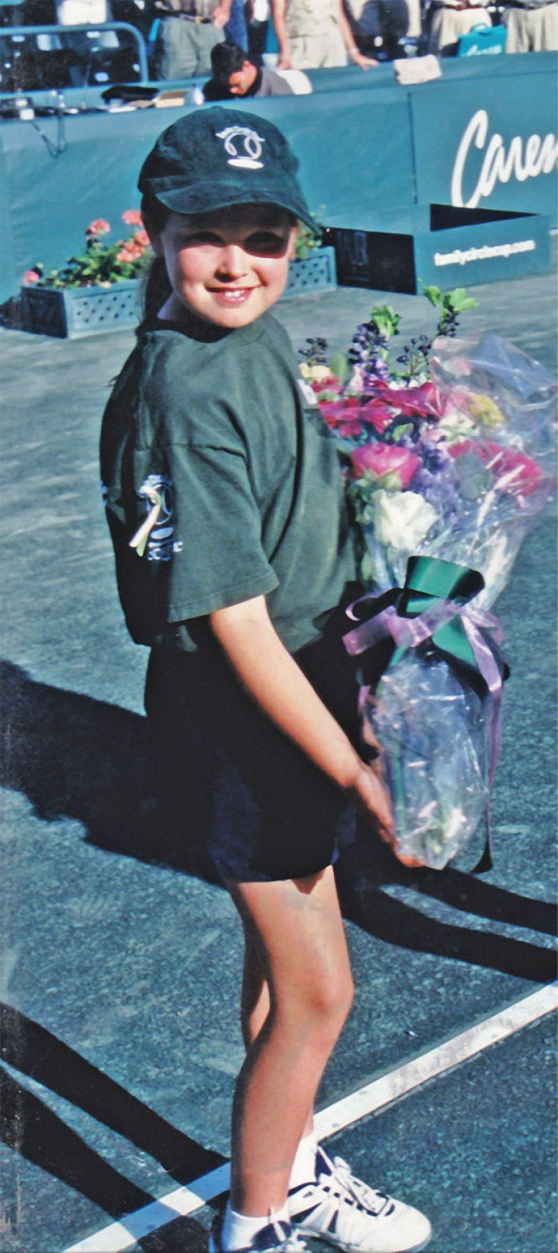In 2001, as an eight-year-old ball crew member, Rogers was chosen to hand a bouquet to 2001 Family Circle Cup champion Jennifer Capriati.