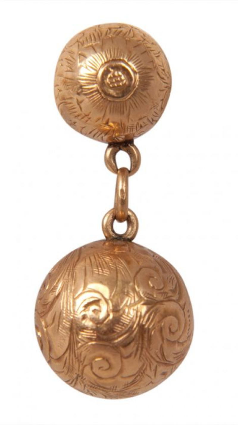 14K gold ball earrings with chain link, $585 at Croghan's Jewel Box; photograph by Sophia Parker