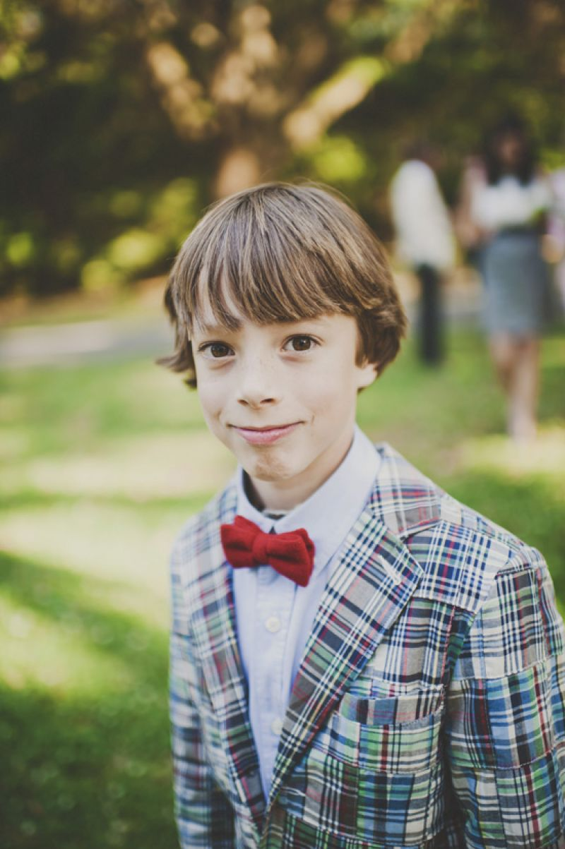 DRESS SHARP: Cousin of the bride Ellis Moore showed off a dapper plaid blazer and bright red bow tie.