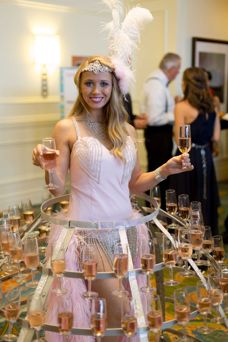 "The lovely ""Champagne Lady"" served guests glasses of pink bubbly as they arrived."