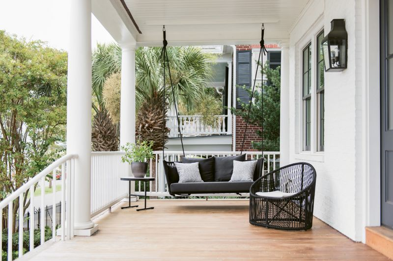 A sculptural loveseat-size swing by Spanish company Kettal provides a modern twist on the classic Charleston front-porch experience.