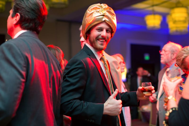 A turbaned guest enjoyed dancing and drinks.