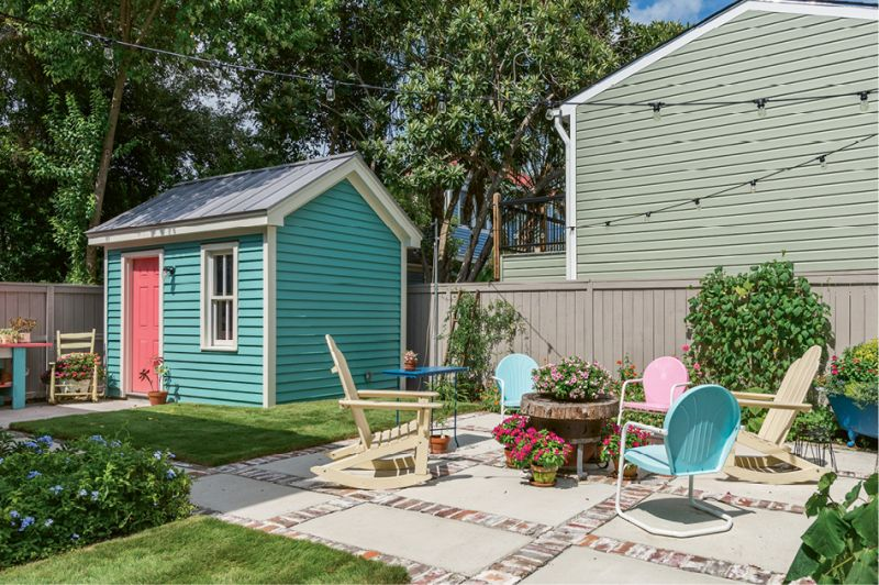 The coral door on the new gardening shed brings a fun dose of color to the scene.