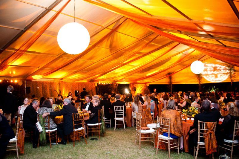 Giant globe lanterns illuminated the tents.