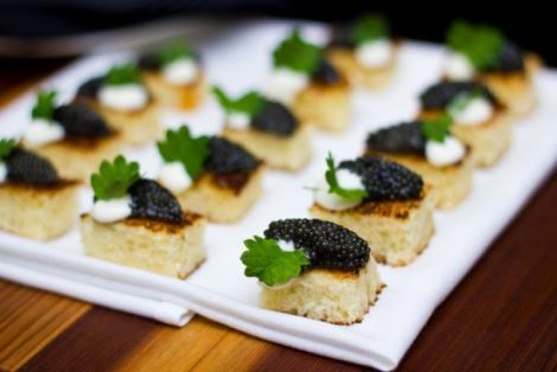 Featured hors d'oeuvres included fresh caviar, roasted tomato puree, and braised lamb.