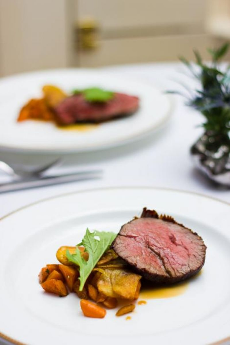 McCrady's wagyu beef tenderloin served with potato galette, carrot, and sauce perigord.