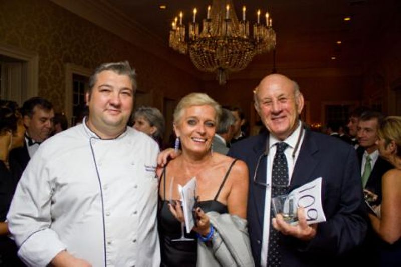 One of the night's big auction items was dinner prepared by the Harbour Club's Chef Travis Overholt, seen here with Gerline Sievert and Gene Vlanton.