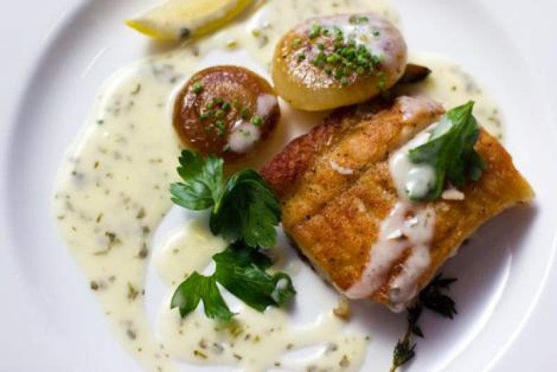 McCrady's local flounder with baked onion and parsley sauce.