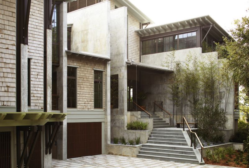 Concrete Ideas: Architect Jim Thomas designed the earthy, modern residence to fit an irregular marshfront peninsula; a series of staggered, parallel concrete walls served as his dominant design principle.