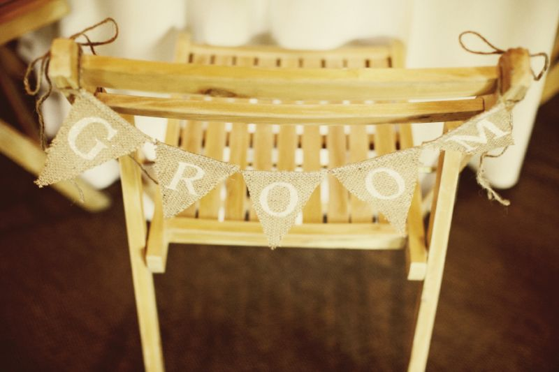 SAVE MY SEAT: His and her burlap banners from Etsy's Funkyshique hung on the couple's chairs.