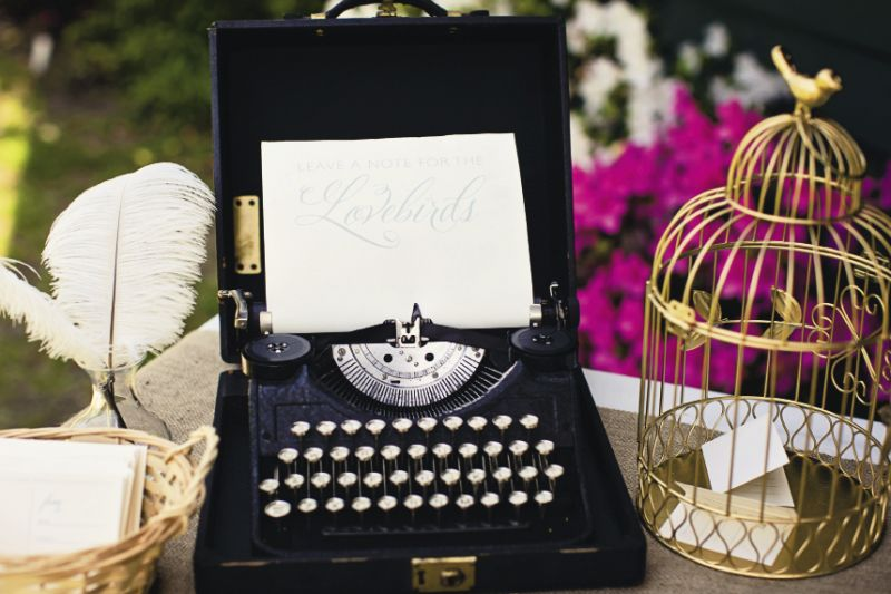 THINK OUTSIDE THE BOX: The bride found wire birdcages at Michaels for $4 each. To suit the reception's color scheme, she spray-painted them gold. The typewriter was an antique rustled up from her parents' garage.