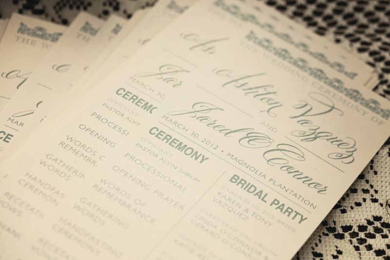 TO THE LETTER: Ashton, who designed their stationery, accented their programs with vivid aquamarine lettering.