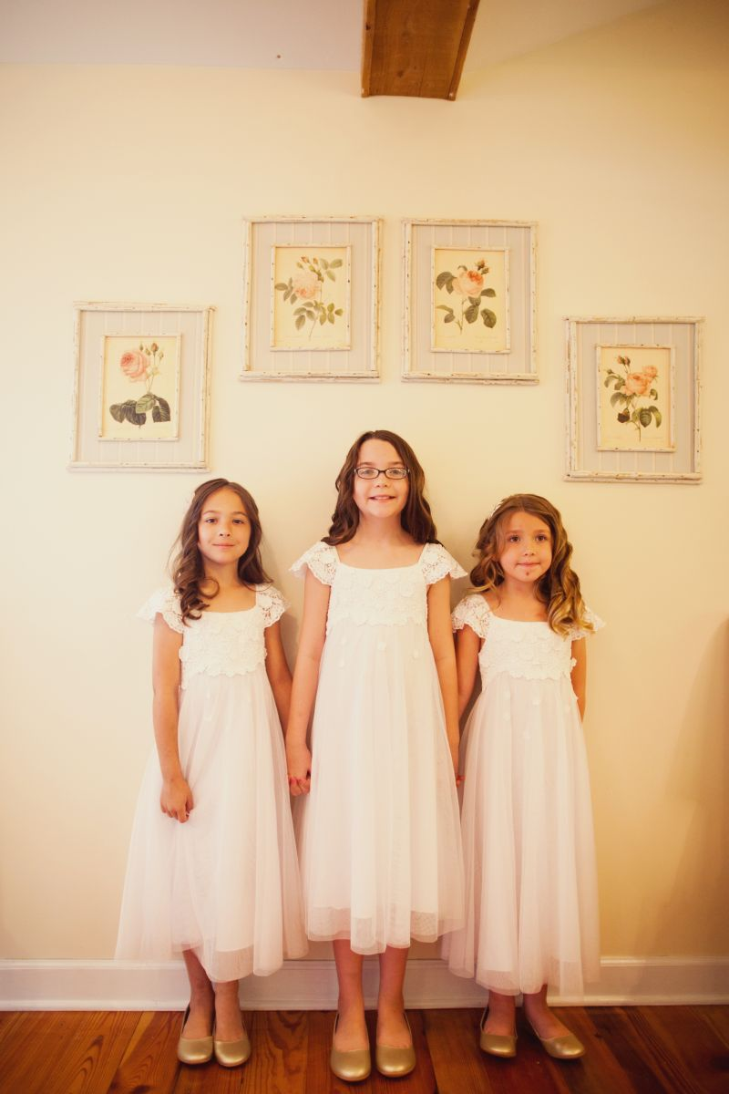 CUTIE PIES: Bridesmaids Elizabeth, Ella, and Gwyneth wore long, flowing Monique Lhuillier frocks from Nordstrom.