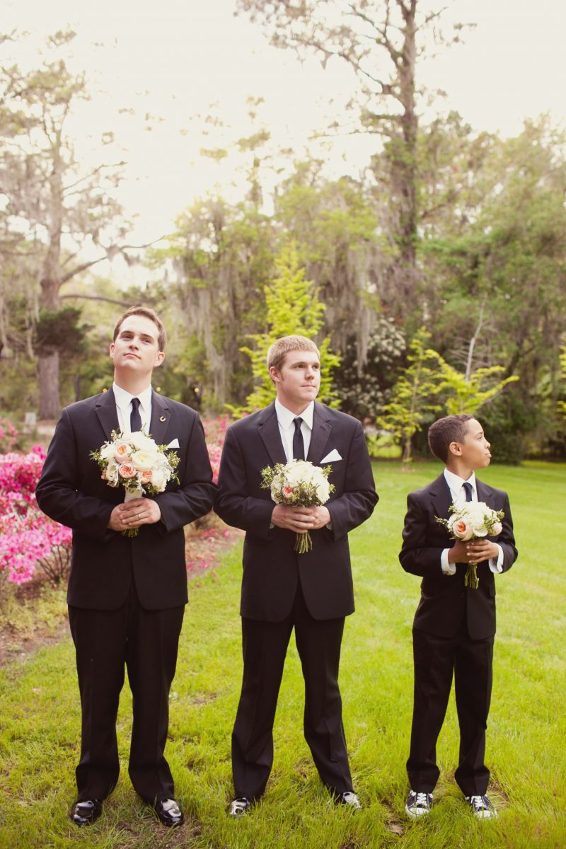 SUIT UP: The groom and his companions wore Men's Wearhouse. Junior groomsman Gavin added age-appropriate flair to his get-up with black-and-white Converse.