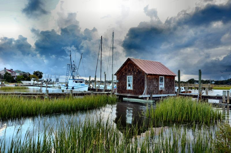 "WINNER! Amateur category: Before the Storm by Pamela Talbird; ""I was driving through Mt. Pleasant when a storm was moving in.  The sky was changing drastically so I stopped off at Shem Creek to shoot a few photos before the downpour."""