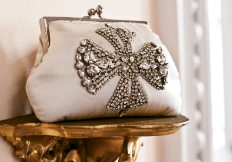 Ivory satin clutch with rhinestone cross from Out of Hand ($235)
