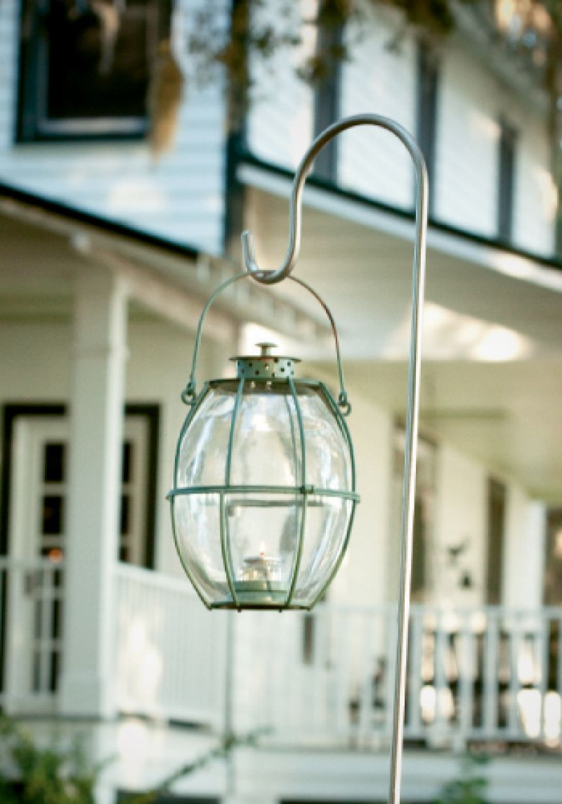 Lindsay borrowed lanterns from a friend, and hung them on shepherd hooks to create pathways across the lawn.