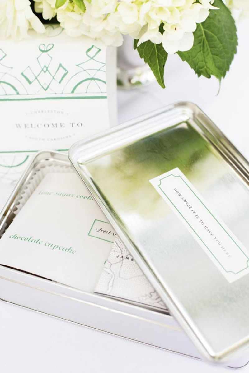A SILVER SALUTATION: Welcome boxes (accented with green touches) offered sweets, an itinerary, and a list of restaurant recommendations.