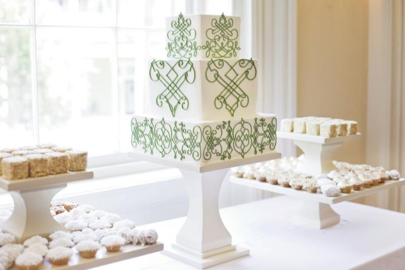 PATTERN PLAY: The three-tiered treat from Wedding Cakes by Jim Smeal mirrored the design and palette of the couple's stationery suite.