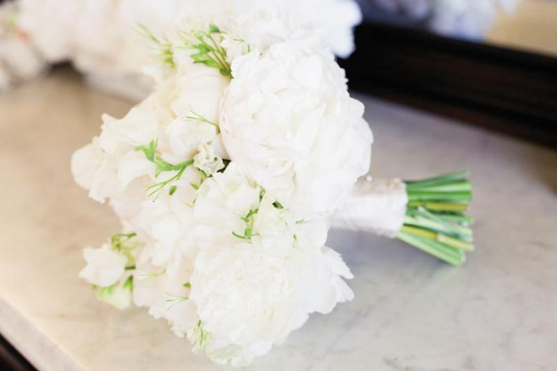 "WHAT A BUNCH: ""It was simple, classic, and appropriate,"" Jessica says of her bouquet of white peonies, lisianthus, and sweet peas by Gathering Floral + Event Design's Heather Barrie."