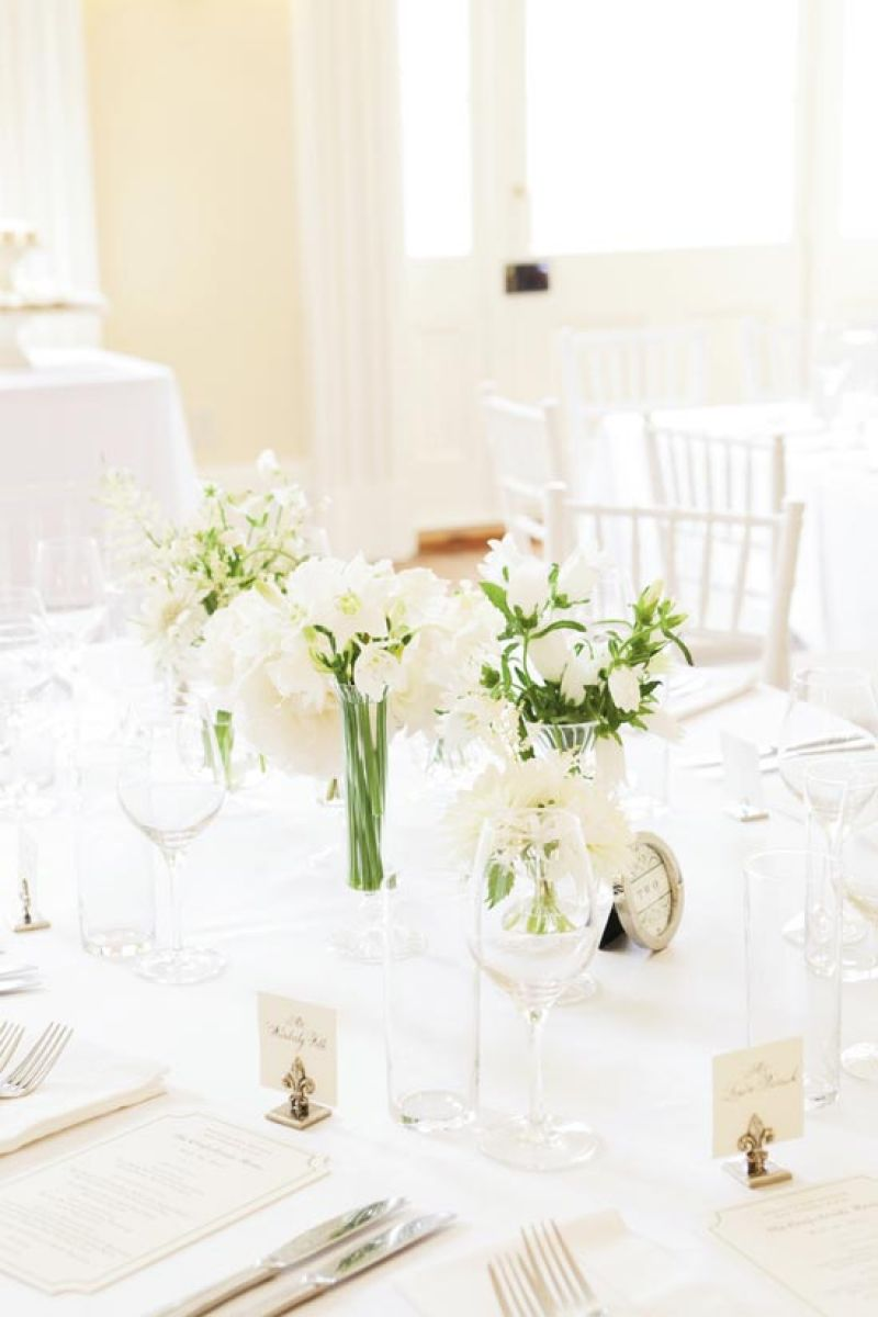 FRESH SET: White chairs and linens from Snyder Event Rentals kept the ballroom airy, while florals lent an organic touch to the brunch's traditional settings.