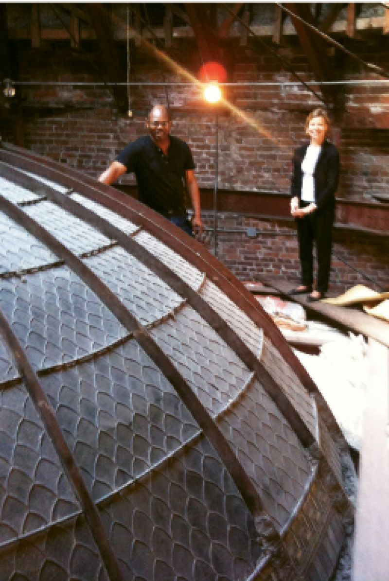 Gibbes operations manager Greg Jenkins and lighting consultant Anita Jorgensen examine the dome structure from above the Rotunda Gallery.
