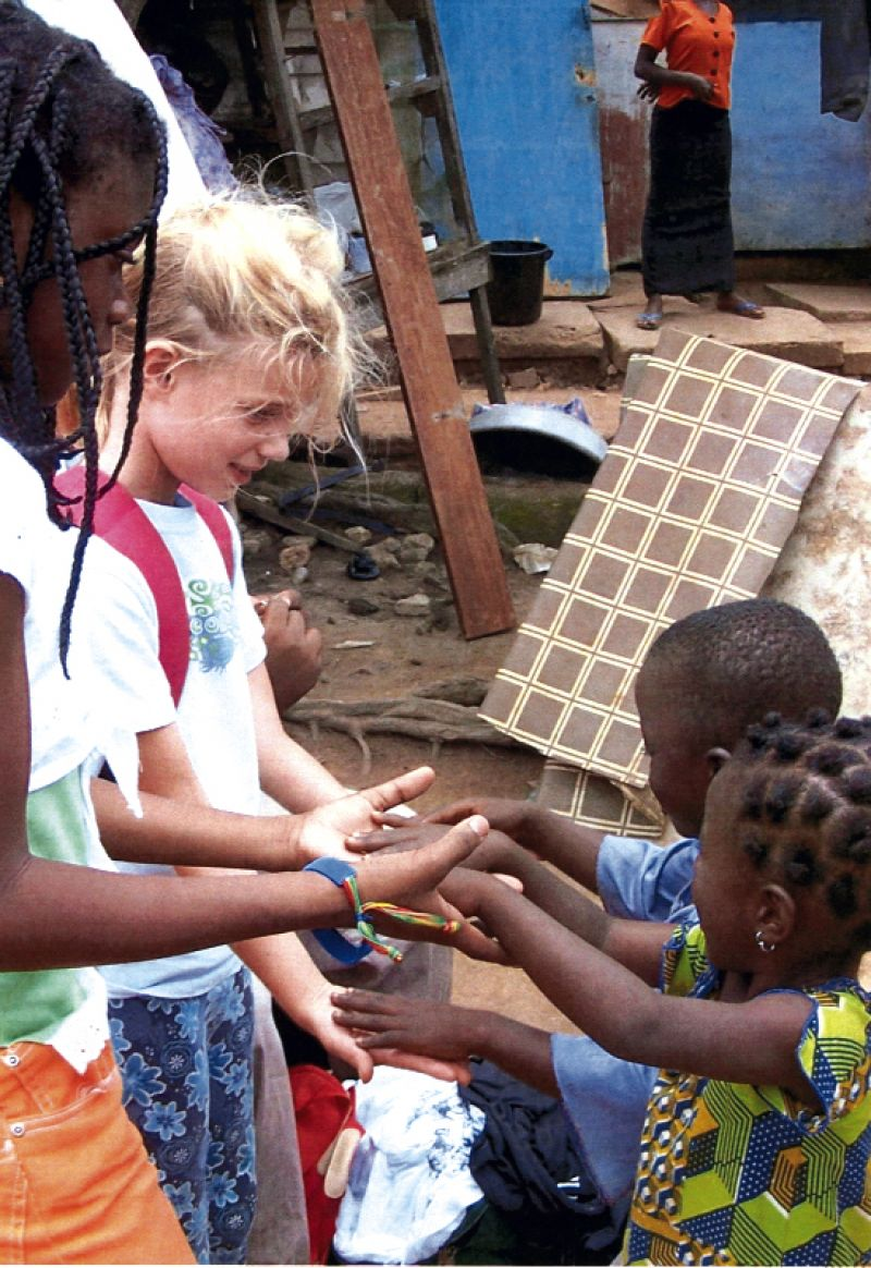 hop14.jpgConnections: Ignoring the language barrier, visitors from Charleston play games with young Ghanian children.