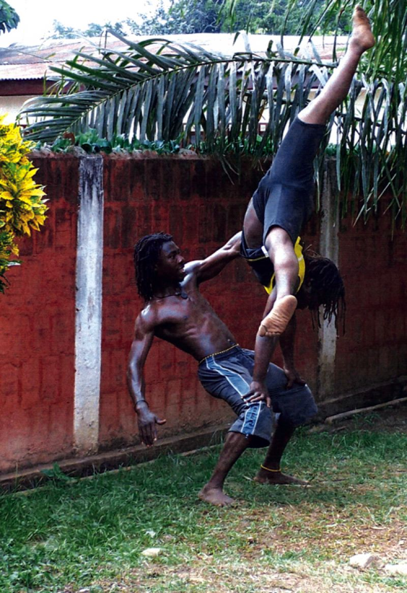 Two members of Nkabom defy gravity.