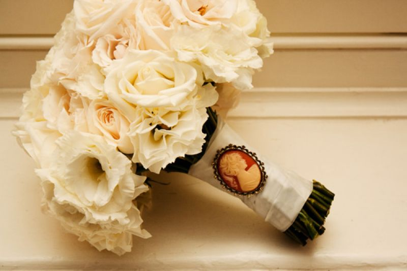 """AN ANTIQUE TOUCH: A family pendant (passed down for four generations) old added """"something old"""" to Aly's white rose bouquet by Gathering Floral + Event Design"""