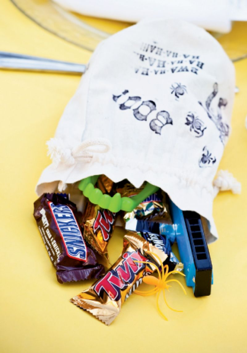Goodie Bag: Calder stamped drawstring muslin bags with Halloween sayings and stuffed them full of candy and toys, like fake fangs and spider rings. Inexpensive treats can be found at dollar stores and discount chains. Order plain bags online and get ink stamps from craft stores.