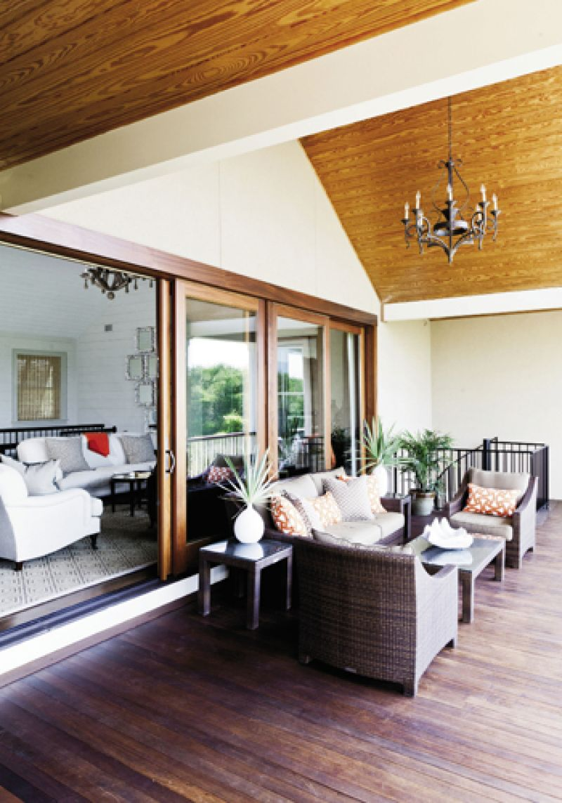 Lofty Ideas: The wide-open great room gives way to a cozy porch with vaulted ceilings.