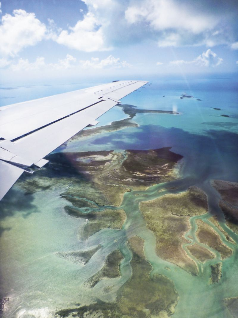 Flying above the Exumas' more than 360 islands, some just tiny cays of coral and sand