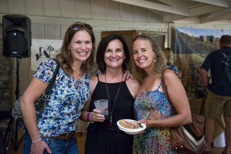 LLF board member Elena Hacker, executive director Jamee Haley, and Glass Onion's co-owner-and-chef Sarah O'Kelly enjoy local beer and food before the live auction begins.