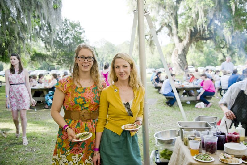 Sarah Jo Willis and Heather Keeler hang out under the tent while enjoying plates from Cypress.