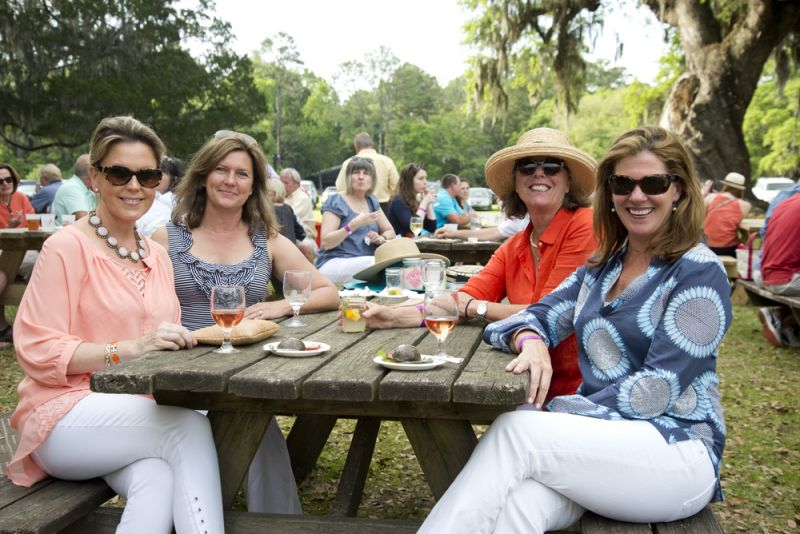 Kristy Dukelow, Gayle Woodward, Charleston magazine club member Chellie Kew, and Lynann Harder enjoy the shrimp burgers from The Ordinary.